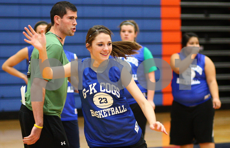 Kyle Bursaw – kbursaw@shawmedia.com<br /> <br /> Genoa-Kingston Andrea Strohmaier signals as she makes a cut past coach Kyle Henkel during practice on Monday, Oct. 29, 2012.