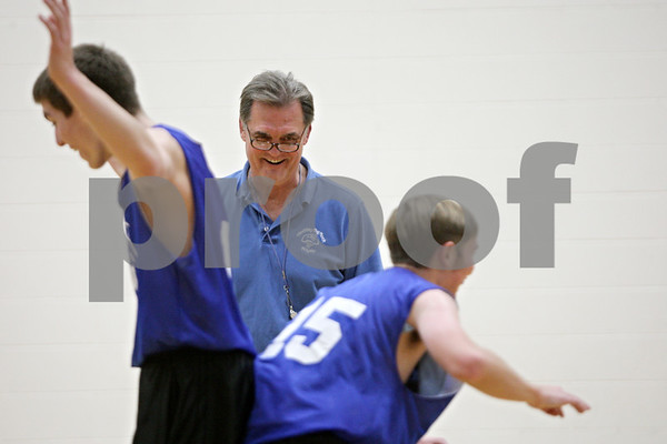 Rob Winner – rwinner@shawmedia.com<br /> <br /> Hinckley-Big Rock Bill Sambrookes watches as two of his players participate in a positioning drill during practice in Hinckley Wednesday, Nov. 7, 2012.