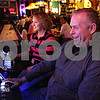 Rob Winner – rwinner@shawmedia.com<br /> <br /> David Busch (front) and Michele Enburg each try out the new video gambling machines at Houlahan's Tavern and Grill in Waterman, Ill., Friday, Nov. 16, 2012. The tavern, which has three gambling machines, is one of the first in DeKalb county.