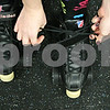 Rob Winner – rwinner@shawmedia.com<br /> <br /> Kristin Spickerman, or Tootsie Bang Bang, laces up her skates before a Barbed Wire Betties roller derby practice at the Kishwaukee Family YMCA in DeKalb, Ill., Friday, Nov. 16, 2012.
