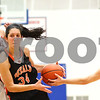 Kyle Bursaw – kbursaw@shawmedia.com<br /> <br /> Naperville North's Lauren LoLordo forces DeKalb guard Rachel Torres to lose the ball while making a move around North's Kayla Sharples in the second quarter of DeKalb's 49-30 victory over Naperville North in the Lady War Hawk Thanksgiving girls basketball tournament at West Aurora High School on Friday, Nov. 23, 2012