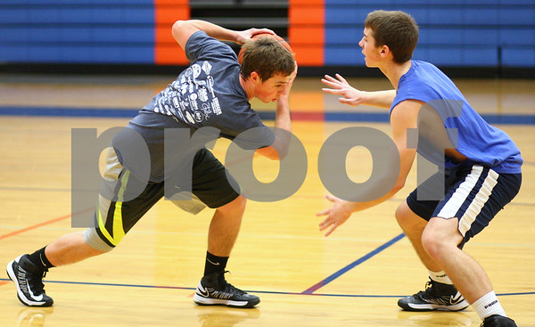 Kyle Bursaw – kbursaw@shawmedia.com<br /> <br /> Genoa-Kingston's Mason Lucca (left) tries to work past defending teammate Blake Munro during a drill at practice on Monday, Nov. 5, 2012.