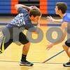 Kyle Bursaw – kbursaw@shawmedia.com<br /> <br /> Genoa-Kingston's Mason Lucca (left) tries to work past defending teammate Blake Munro during a drill at practice on Monday, Nov. 5, 2012.