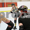 Rob Winner – rwinner@shawmedia.com<br /> <br /> Bri Kness, known as Brawl Burner on the rink, instructs her teammates on how to check someone during a Barbed Wire Betties roller derby practice at the Kishwaukee Family YMCA in DeKalb, Ill., Friday, Nov. 16, 2012.