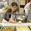 Rob Winner – rwinner@shawmedia.com<br /> <br /> Sycamore resident Heidi Phelps prepares a meal for a patron to the community Thanksgiving dinner at the Evangelical Lutheran Church of St. John in Sycamore, Ill., Thursday, Nov. 22, 2012.