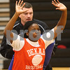 Kyle Bursaw – kbursaw@shawmedia.com<br /> <br /> DeKalb coach Chris Davenport plays defender during a drill with senior Janay Wright at practice in DeKalb High School on Tuesday, Oct. 30, 2012.