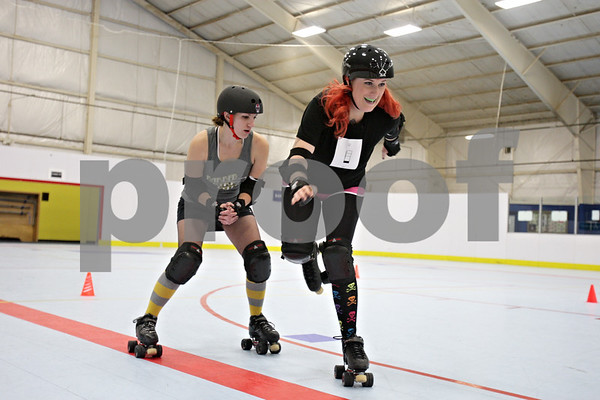 Rob Winner – rwinner@shawmedia.com<br /> <br /> Kristin Spickerman (right) practices a hip check with teammate Bri Kness during a Barbed Wire Betties roller derby practice at the Kishwaukee Family YMCA in DeKalb, Ill., Friday, Nov. 16, 2012.