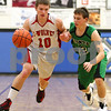 Kyle Bursaw – kbursaw@shawmedia.com<br /> <br /> Indian Creek guard Jaron Todd makes a move to get past Alden-Hebron's Hunter Ogle in the first quarter. Indian Creek defeated Alden-Hebron 61-30 in the Warrior Thanksgiving Basketball Classic at Westminster Christian High School in Elgin, Ill. on Tuesday, Nov. 20, 2012.
