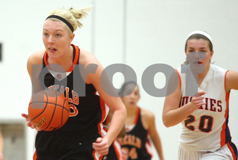 Kyle Bursaw – kbursaw@shawmedia.com<br /> <br /> DeKalb's Madelyne Johnson hustles down the court with Naperville North's Chloe O'Dekirk in pursuit after the Barbs defense forced a turnover in the first quarter of DeKalb's 49-30 victory over Naperville North in the Lady War Hawk Thanksgiving girls basketball tournament at West Aurora High School on Friday, Nov. 23, 2012