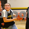 Kyle Bursaw – kbursaw@shawmedia.com<br /> <br /> Sycamore's Bailey Gilbert makes a move around teammate Julia Moll (left) as sophomore coach Neilly Berger (background) watches over the drill during practice on Thursday, Nov. 1, 2012.