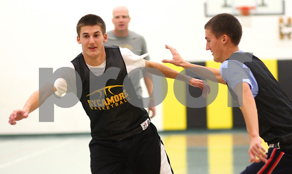 Kyle Bursaw – kbursaw@shawmedia.com<br /> <br /> Sycamore's Kyle Buzzard (right) defends brother Curt Buzzard as he tries to get open on Monday, Nov. 5, 2012.