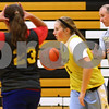 Kyle Bursaw – kbursaw@shawmedia.com<br /> <br /> Sycamore coach Brett Goff works with his players including Bailey Gilbert (center) and Julia Moll (23) during practice on Thursday, Nov. 1, 2012.