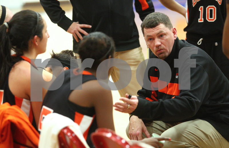 Kyle Bursaw – kbursaw@shawmedia.com<br /> <br /> DeKalb coach Chris Davenport talks to his players during a timeout in the third quarter of DeKalb's 49-30 victory over Naperville North in the Lady War Hawk Thanksgiving girls basketball tournament at West Aurora High School on Friday, Nov. 23, 2012