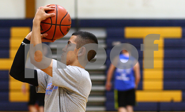 Kyle Bursaw – kbursaw@shawmedia.com<br /> <br /> Hiawatha's Ed Canchola takes a shot at practice on Tuesday, Nov. 6, 2012.