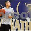 Kyle Bursaw – kbursaw@shawmedia.com<br /> <br /> Hiawatha's Ed Canchola grabs a rebound during a drill at practice on Tuesday, Nov. 6, 2012.
