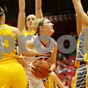 Rob Winner – rwinner@shawmedia.com<br /> <br /> Northern Illinois center McKenzie Hoelmenn (center) is fouled by South Dakota State guard Gabrielle Boever (4) while controlling an offensive rebound during the first half at the Convocation Center in DeKalb, Ill., Wednesday, Nov. 21, 2012.