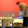 Kyle Bursaw – kbursaw@shawmedia.com<br /> <br /> Mike Heath, of Dixon, bags turkeys and loads them into a shopping cart at the Salvation Army in DeKalb, Ill. on Tuesday, Nov. 20, 2012. Heath and other volunteers helped distribute food to more than 700 families.