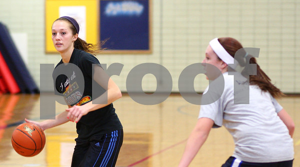 Kyle Bursaw – kbursaw@shawmedia.com<br /> <br /> Hiawatha's Dani Clark controls the ball during a drill at practice on Monday, Oct. 29, 2012.