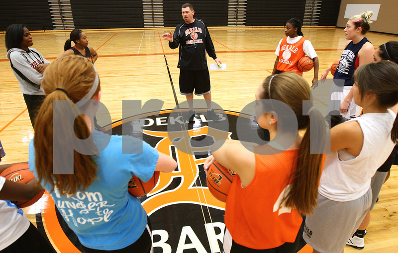 Kyle Bursaw – kbursaw@shawmedia.com<br /> <br /> DeKalb coach Chris Davenport talks to his players at center court in DeKalb High School on Tuesday, Oct. 30, 2012.