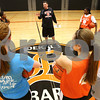 Kyle Bursaw – kbursaw@shawmedia.com<br /> <br /> DeKalb coach Chris Davenport talks to his players at center court in DeKalb High School on Tuesday, Oct. 30, 2012.