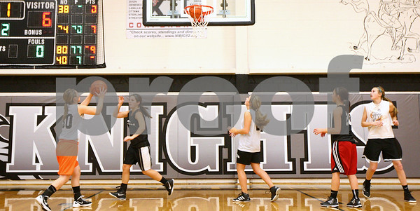 Kyle Bursaw – kbursaw@shawmedia.com<br /> <br /> Five members of the Kaneland girls basketball team run a drill where they try to make a combined 40 shots in one minute at practice on Tuesday, Oct. 30, 2012.