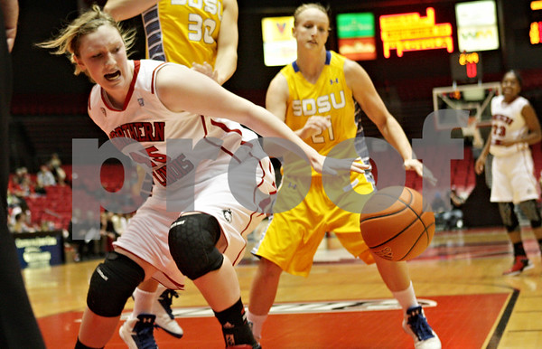 Rob Winner – rwinner@shawmedia.com<br /> <br /> Northern Illinois center McKenzie Hoelmenn (45) loses the ball under the basket during the first half at the Convocation Center in DeKalb, Ill., Wednesday, Nov. 21, 2012.