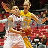 Rob Winner – rwinner@shawmedia.com<br /> <br /> Northern Illinois guard Amanda Corral (22) goes to the basket as South Dakota State forward Leah Dietel (21) trails during the first half at the Convocation Center in DeKalb, Ill., Wednesday, Nov. 21, 2012.