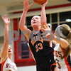 Kyle Bursaw – kbursaw@shawmedia.com<br /> <br /> DeKalb's Madelyne Johnson puts up a shot between the defense of Naperville North's Chloe O'Dekirk (left) and Lauren LoLordo in the first quarter of DeKalb's 49-30 victory over Naperville North in the Lady War Hawk Thanksgiving girls basketball tournament at West Aurora High School on Friday, Nov. 23, 2012