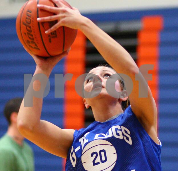 Kyle Bursaw – kbursaw@shawmedia.com<br /> <br /> Genoa-Kingston's Tori Hensley takes a shot during practice on Monday, Oct. 29, 2012.