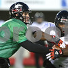 Kyle Bursaw – kbursaw@shawmedia.com<br /> <br /> Northern Illinois quarterback Jordan Lynch fakes a handoff to Northern Illinois running back Giorgio Bowers during practice on Tuesday, Nov. 27, 2012.