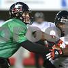 Kyle Bursaw – kbursaw@shawmedia.com<br /> <br /> Northern Illinois quarterback Jordan Lynch fakes a handoff to Northern Illinois running back Giorgio Bowers during practice on Tuesday, Nov. 27, 2012.