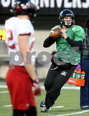 Kyle Bursaw – kbursaw@shawmedia.com<br /> <br /> Northern Illinois quarterback Jordan Lynch (6) sets his feet to pass during practice on Tuesday, Nov. 27, 2012.