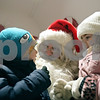 Rob Winner – rwinner@shawmedia.com<br /> <br /> Calvin Page, 4, of DeKalb, and his sister Noël Page, 5, tell Santa Claus some of the items on their wish list in downtown DeKalb, Ill., Thursday, Nov. 29, 2012.