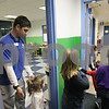 Rob Winner – rwinner@shawmedia.com<br /> <br /> Youth development coordinator John Quade (left) helps direct a group of children from the Kid Zone down to the Activity Center at the Kishwaukee Family YMCA in Sycamore, Ill., Tuesday, Nov. 27, 2012.