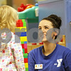 Rob Winner – rwinner@shawmedia.com<br /> <br /> Sierra Holder (right), a staff member at the YMCA, speaks with Kailyn Mills, 2, while constructing a tower with building blocks in the Kid Zone at the Kishwaukee Family YMCA in Sycamore, Ill., Tuesday, Nov. 27, 2012.