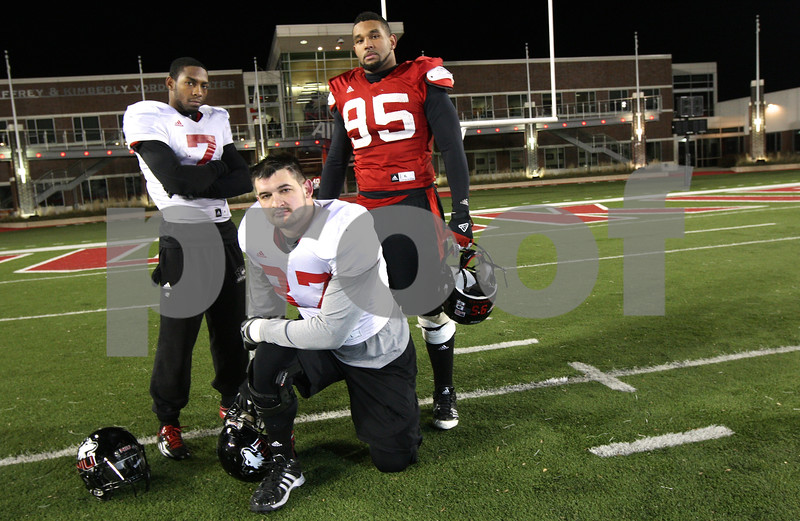 Kyle Bursaw – kbursaw@shawmedia.com<br /> <br /> This year's Northern Illinois senior class, including wide receiver Perez Ashford (from left), tight end Jason Schepler and defensive end Sean Progar (95), is the winningest class in school history.<br /> <br /> Taken at Huskie Stadium on Tuesday, Nov. 27, 2012.
