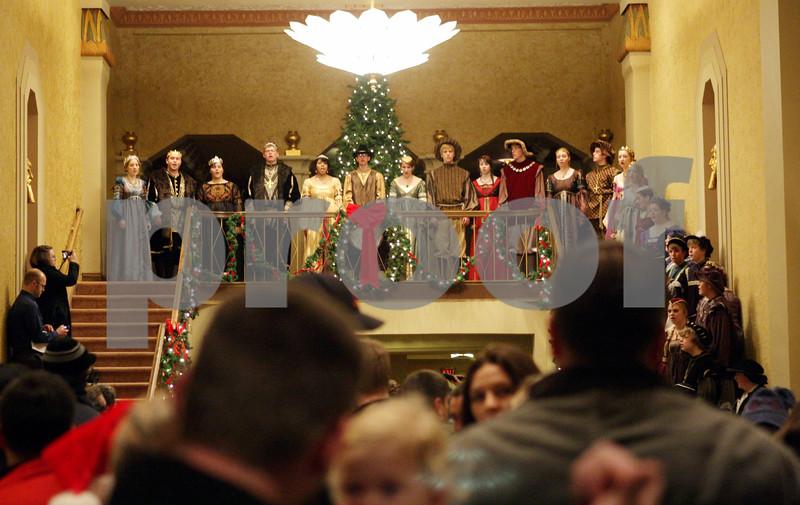 Rob Winner – rwinner@shawmedia.com<br /> <br /> Madrigal singers from DeKalb High School entertain a crowd inside the Egyptian Theatre before the arrival of Santa Claus in downtown DeKalb, Ill., Thursday, Nov. 29, 2012.