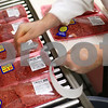 Kyle Bursaw – kbursaw@shawmedia.com<br /> <br /> David Johnson puts stickers on cube steaks advertising the Brown's Country Market meat department's five for $19.99 mix or match deal in Sycamore, Ill. on Monday, Nov. 26, 2012.