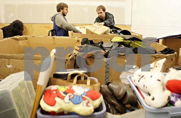 Rob Winner – rwinner@shawmedia.com<br /> <br /> Jake Michael (left) and Daniel Zoberis sort through items donated to Goodwill in DeKalb, Ill., Saturday, Nov. 24, 2012.