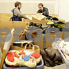 Rob Winner – rwinner@shawmedia.com<br /> <br /> Jake Michael (left) and Daniel Zoberis sort through items donated to Goodwill in DeKalb, Ill., Saturday, Nov. 24, 2012.