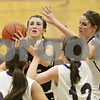 Rob Winner – rwinner@shawmedia.com<br /> <br /> Sycamore's Lauren Goff tries to get a shot off while being pressured by three Rochelle defenders during the second quarter in Rochelle, Ill., Friday, Nov. 30, 2012. Rochelle defeated Sycamore, 52-49.
