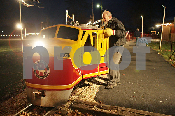 Rob Winner – rwinner@shawmedia.com<br /> <br /> Train engineer Bobby Bach begins boarding the Holiday Lights Train at Lions Community Park in Waterman, Ill., Saturday, Nov. 24, 2012. This is the 19th annual Holiday Lights Train event that runs until the end of December and admission is free.