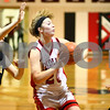 Kyle Bursaw – kbursaw@shawmedia.com<br /> <br /> Indian Creek's Kate Thuestad fires off a pass while being guarded by Putnam County's Allison Voss (44) in the first quarter. Indian Creek fell to Putnam County 53-41 at Indian Creek High School on Monday, Nov. 26, 2012.