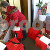 Kyle Bursaw – kbursaw@shawmedia.com<br /> <br /> Marianne Egland puts out donated baked goods for volunteers driving Meals on Wheels routes while working around the red meal bags waiting to be picked up by drivers the Voluntary Action Center in Sycamore, Ill. on Tuesday, Nov. 27, 2012.