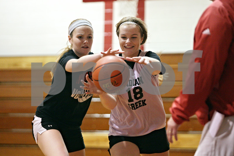 Rob Winner – rwinner@shawmedia.com<br /> <br /> Emma Goodrich (left) attempts to steal the ball from her twin Rebekah Goodrich during an Indian Creek practice in Shabbona Wednesday, Oct. 31, 2012.