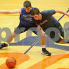 Kyle Bursaw – kbursaw@shawmedia.com<br /> <br /> Genoa-Kingston's Mason Lucca (right) tries to get around teammate Blake Munro and grab the ball during a drill at practice on Monday, Nov. 5, 2012.