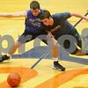 Kyle Bursaw – kbursaw@shawmedia.com<br /> <br /> Genoa-Kingston's Mason Lucca (right) tries to get around teammate Blake Munro and grab the ball during a drill at practice on Monday, Nov. 5, 2012.