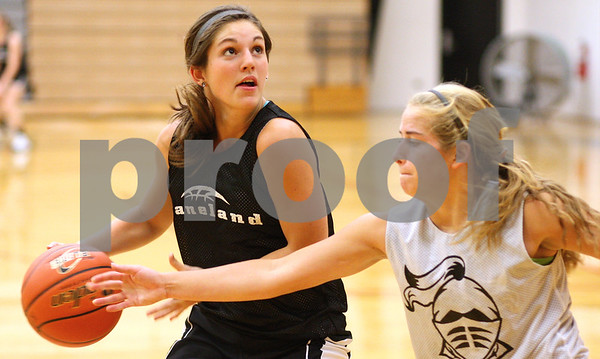 Kyle Bursaw – kbursaw@shawmedia.com<br /> <br /> Kaneland's Brooke Harner looks for a shot as teammate Sarah Grams defends her during practice at Kaneland High School on Tuesday, Oct. 30, 2012.