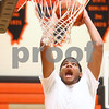 Kyle Bursaw – kbursaw@shawmedia.com<br /> <br /> DeKalb's Andre Harris slams one in the hoop at practice on Wednesday, Nov. 7, 2012.