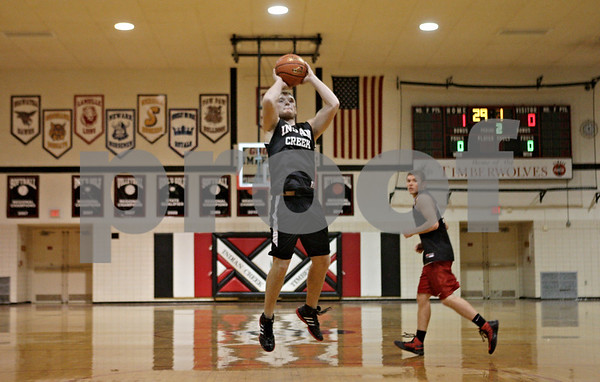 Rob Winner – rwinner@shawmedia.com<br /> <br /> Indian Creek's Jake Bjorneby takes a jump shot during practice in Shabbona Wednesday, Nov. 7, 2012.